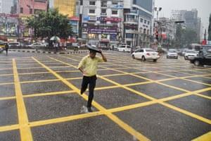 A man runs across a junction in Dhaka, Bangladesh