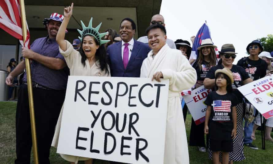 Larry Elder poses for pictures with supporters during a campaign stop in Norwalk, California, in July.
