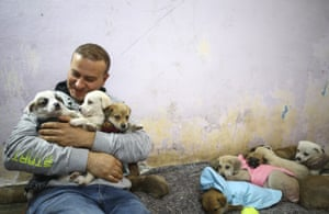 Ankara, TurkeyVolkan Koc pets stray puppies at a house he rented for 29 stray dogs to take shelter during the night and cold weather.
