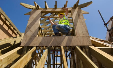 A builder works on a new home