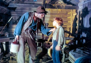 Neville Brand, left, and Eddie Hodges in The Adventures of Huckleberry Finn (1960).