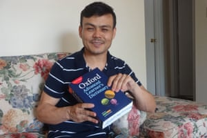 Ghulami with the dictionary he was given on Manus to help him learn English.