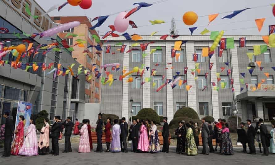 People line up to vote at a polling station in Pyongyang.