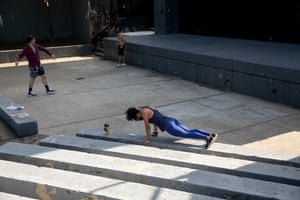 """Andrea Deleon, 20-years-old, works out at Herbert Von King Park in Bedford Stuyvesant, Brooklyn. """"Usually, I go to the gym on my college campus. Since that is closed, I go to the parks to work out. If it's cloudy or cold, I do it in my room. I miss the weights at the gym but it's generally the same. I'm running more which is interesting. At home, I have a stretch band so I use that. It's a good replacement for the weights."""""""