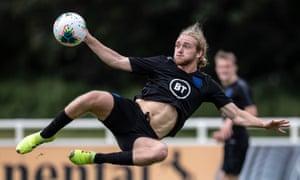 Tom Davies attempts a scissor kick in England training.