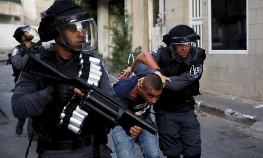 Israel police detain an Israeli Arab during clashes in Nazareth in October