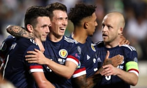 Scotland's John McGinn (left) is congratulated by teammates after scoring the winning goal against Cyprus.