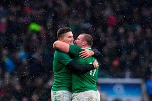 05e792adfa6 Ireland's Jack McGrath (R) embraces Ireland's wing Jacob Stockdale (L) .