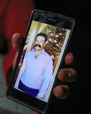 A relative shows a photograph of José Victoriano Barajas, a 57-year-old businessman who was dragged from his ranch near the town of Tecate on 8 April, 2019 and is feared dead.