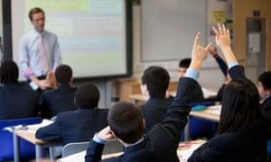 Pupils and teacher in academy school