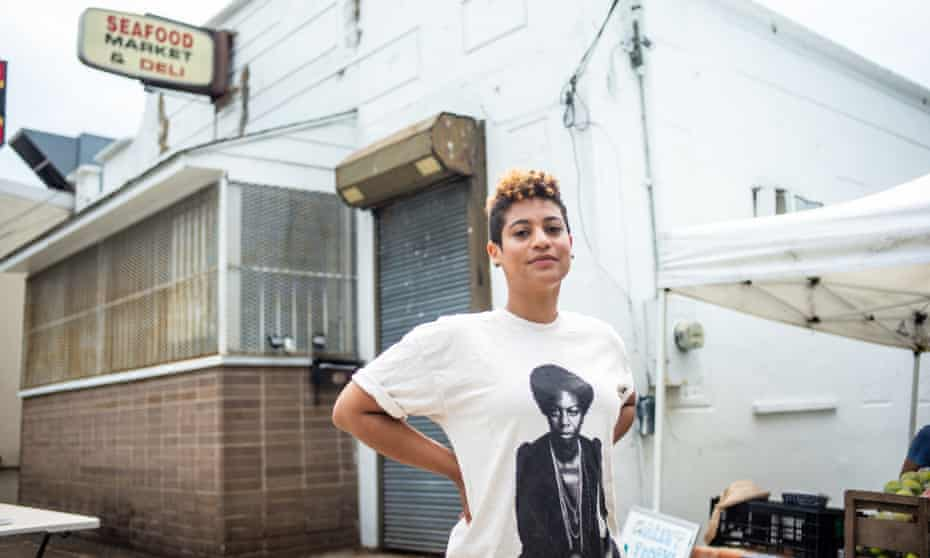 Samantha Pounder, food access director of Arcadia, stands in front of her soon-to-open corner store in the Fort Dupont neighborhood of Washington DC.