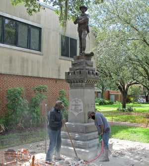 Two workers begin removing a Confederate statue in Gainesville, Florida.