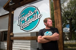 Floyd Landis poses for a portrait in front of his office in Leadville, Colorado.