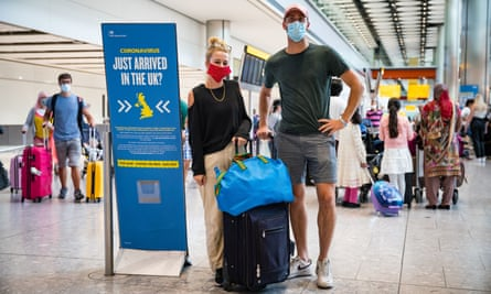 A couple arriving at Heathrow from Croatia, who must self-isolate for 14 days.