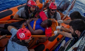Marc Gasol (third from right wearing sunglasses) helps with a rescue effort in the Mediterranean