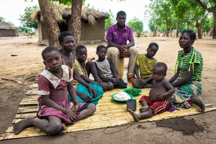 Lucia Bello with some of her children and her sister's orphans, Aloufasi village, Nsanje District, Malawi