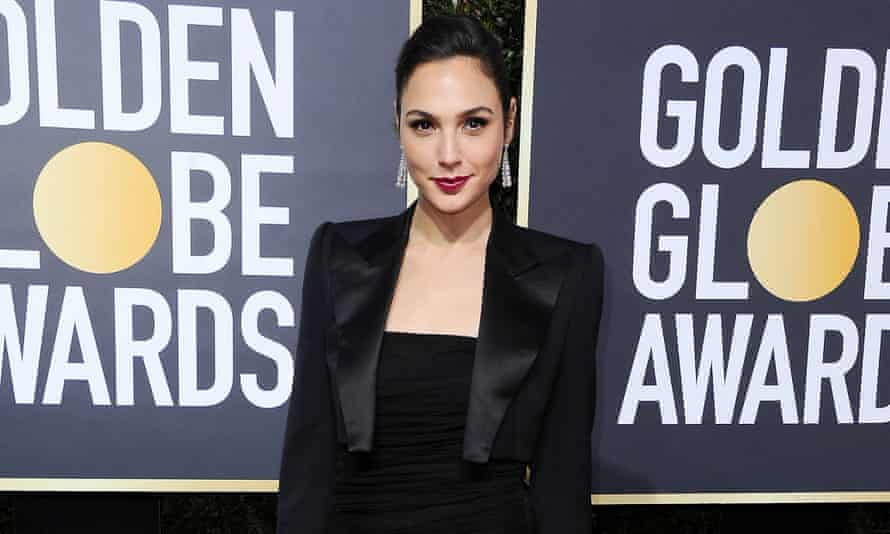 Gal Gadot in a tuxedo-inspired gown.