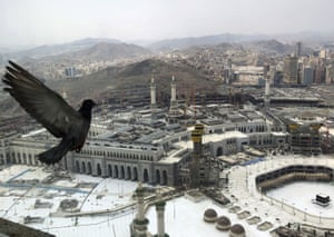 A pigeon flies over the site of the Grand Mosque that is empty due to the coronavirus prevention procedures, on the first day of the annual hajj that normally draws millions of faithful, in the Muslim holy city of Mecca, Saudi Arabia.