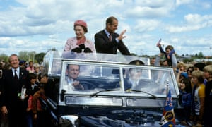 The Queen and Prince Philip wave from their open car in October 1981 in Wellington, New Zealand.