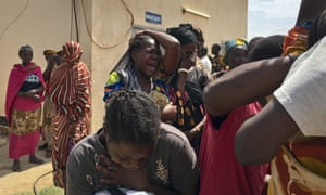 Relatives of the six aid workers who were ambushed and killed grieve outside the morgue in Juba, South Sudan