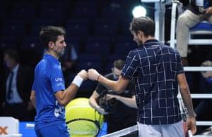 Russia's Daniil Medvedev (R) following his two set win over Serbia's Novak Djokovic.