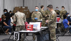 Army medical personnel wait to administer shots at the FEMA-supported Covid-19 vaccination site at Valencia State College on 25 April, the first day the site resumed offering the Johnson & Johnson vaccine following the lifting of the pause ordered by the FDA and the CDC due to blood clot concerns. Most patients opted for the Pfizer vaccine which was also available.