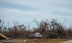 Car tossed into the trees in the section called Freetown on the eastern side of Grand Bahama.
