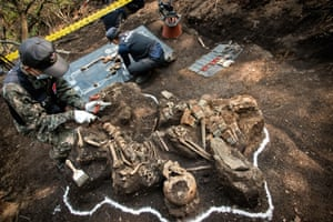 Investigators in 2012 document the remains of a soldier found in the demilitarised zone (DMZ) between North and South Korea.