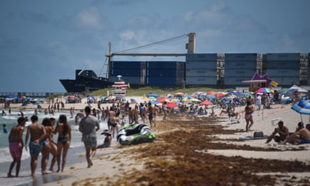 People on a beach in Miami, Florida on Friday.