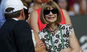 Anna Wintour wears her Wimbledon lanyard.