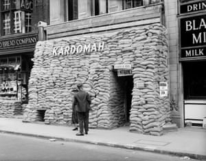 The Kardomah Cafe remains open for hungry journalists behind a mountain of sandbags. The area was a prime target for the Luftwaffe during the second world war