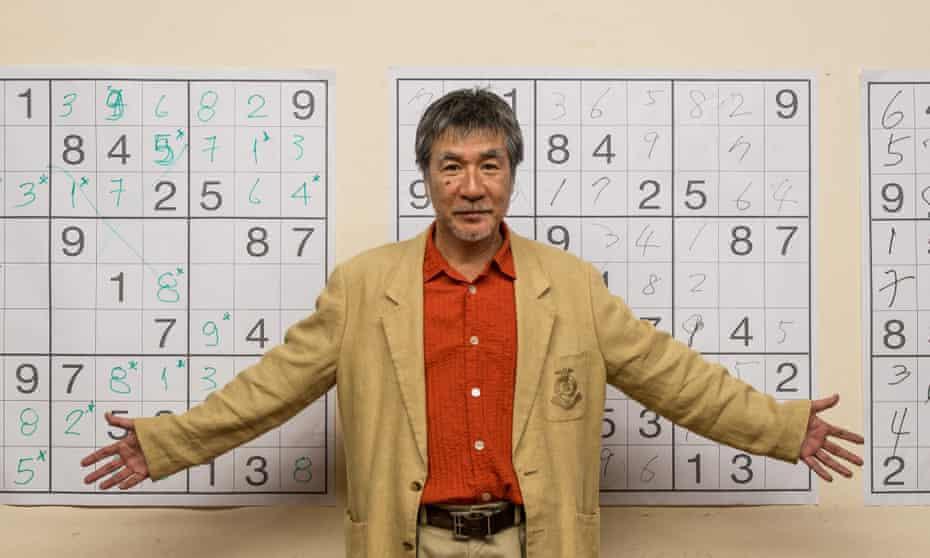Maki Kaji in front of sudoku grids