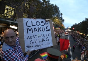 Jeff Stanton holding up a 'Close Manus' placard on the 78ers float.