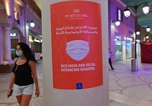 A woman walks in Ibn Battuta mall in the Emirate of Dubai