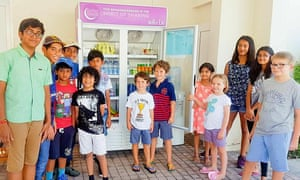 Children in Dubai get in the spirit of stocking public fridges with free food for the city's poor.
