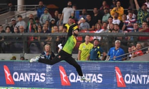 Australian Glenn Maxwell taps the ball back over the boundary before re-catching South Africa captain Faf du Plessis.