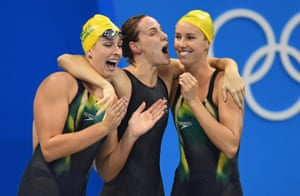 Brittany Elmslie, Emma McKeon and Bronte Campbell of Australia celebrate their new World Record in winning the women's 4x100m Freestyle Relay after Cate Campbell powered home on the final leg.