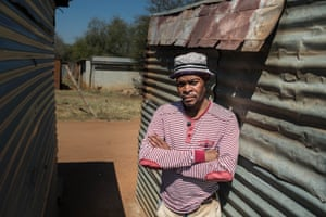 Mohlaudi Mohlaudi, 35, a rock drill operator, stands outside his house