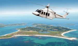A helicopter above the island of Tresco in Scilly.