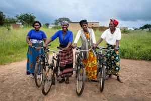 (Left to right) Belinda Syulikwa, Violet Dabali, Beatrice Siankwende, and Judith Siankalou stand with their bikes in Luyaba, Zambia.