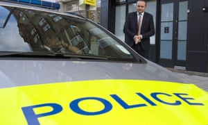 MP Neil Coyle speaks to police parked outside his constituency office in London.