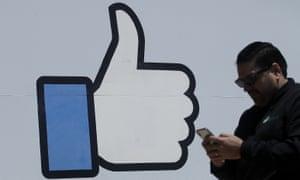 A man walks past the Facebook headquarters in Menlo Park, California.
