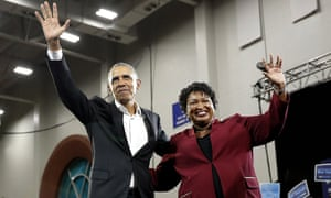 Barack Obama and Stacey Abrams wave to the crowd during a campaign rally at Morehouse College in Atlanta.