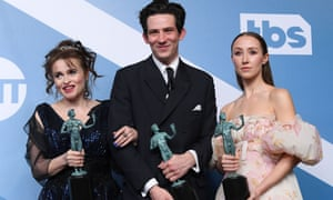 Helena Bonham Carter, Josh O'Connor and Erin Doherty with their awards for outstanding performance by an ensemble in a drama series.