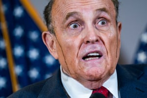 President Trump's personal lawyer Rudy Giuliani perspires as he speaks during a press conference at the Republican national committee headquarters in Washington.