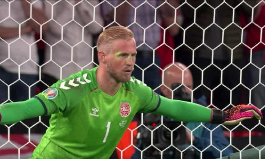 A laser pointer is shone at the Denmark goalkeeper Kasper Schmeichel's face as he prepares to face a penalty in the Euro 2020 semi-final against England.