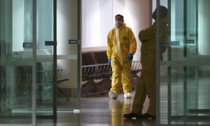 Authorities watch before passengers disembark for immigration procedures on March 30, 2020 in Perth, Australia.