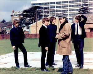 The Beatles on the set of the 1964 film A Hard Day's Night. Left to right: Ringo Starr, John Lennon, George Harrison, director Richard Lester, and Paul McCartney.