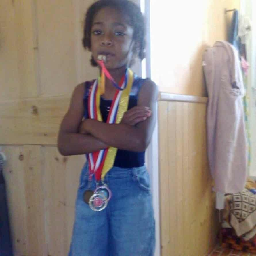 Ella loved playing sports like gymnastics and football
