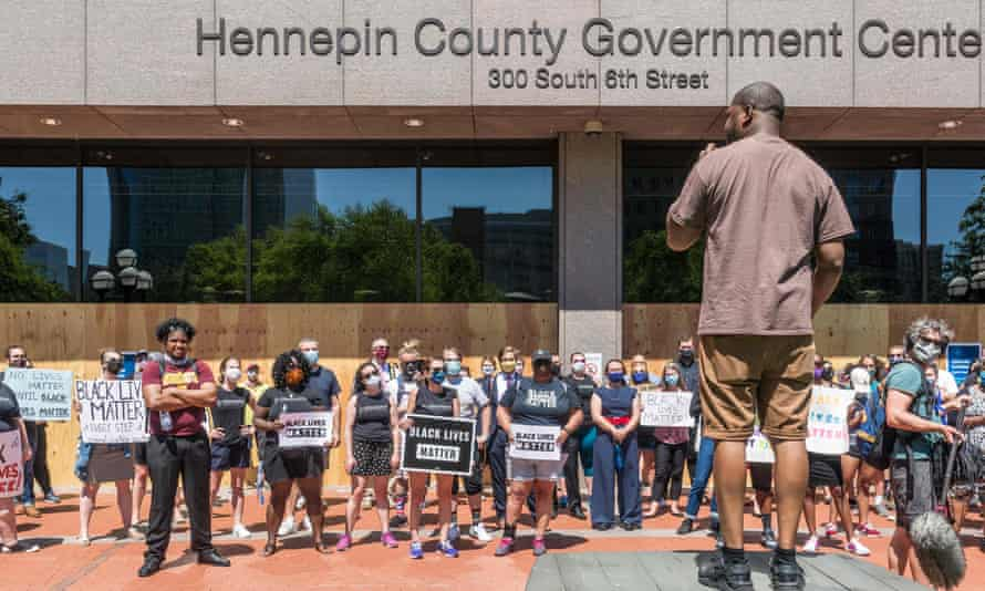 Protesters gather outside the Hennepin county Government Center in Minneapolis, Minnesota, before Derek Chauvin was charged in the death of George Floyd.